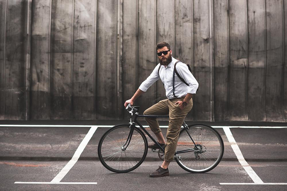 Bearded Man On Bike In Braces